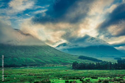 Fotobehang Groen blauw Cold dawn over the mountains of Glencoe, Scotland