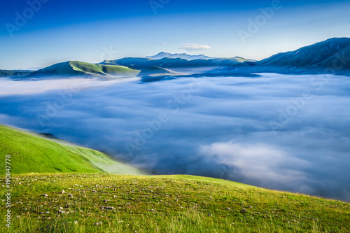 Fotobehang Zonsopgang Stunning dawn in the mountains at Castelluccio, Umbria, Italy