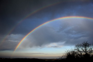 Double rainbow over landscape. Czech Republic.