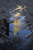 Palazzo Vecchio reflected in a puddle