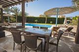 Swimming pool at a luxury tropical holiday villa - 190872142