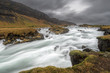 Slow motion capture of waterfall flowing near mountain slope, iceland - 190874373