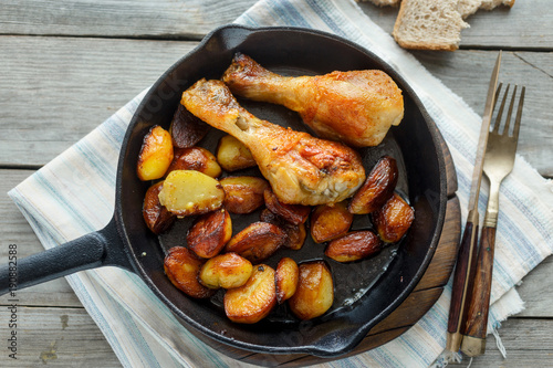 Fried chicken legs, fried potatoes, top view - 190882588