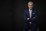 Confident businessman portrait. Executive senior lawyer businessman wearing suit and looking at camera while standing at isolated black background with copy space.  - 190891101