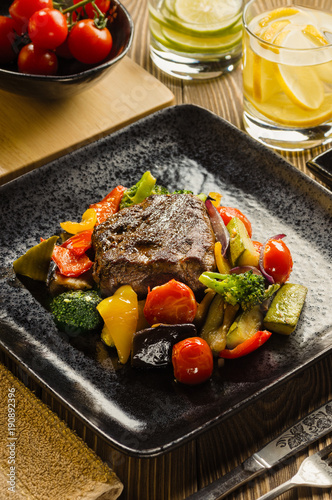 Foto op Canvas Steakhouse Steak with Vegetables Flambe.