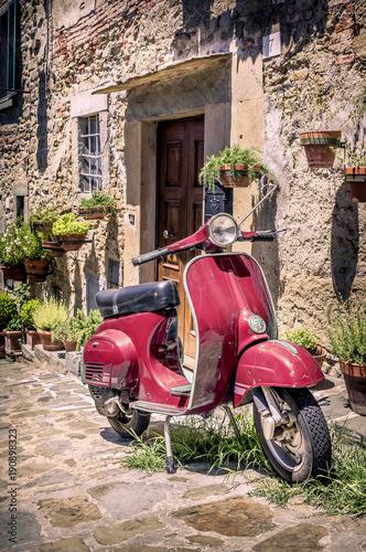 Tuinposter Scooter Red scooter in Tuscany
