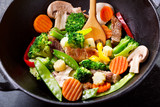 stir fried vegetables with meat in a wok - 190898522