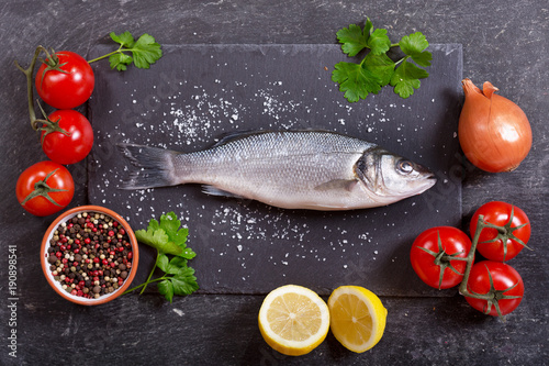 fresh fish sea bass with ingredients for cooking