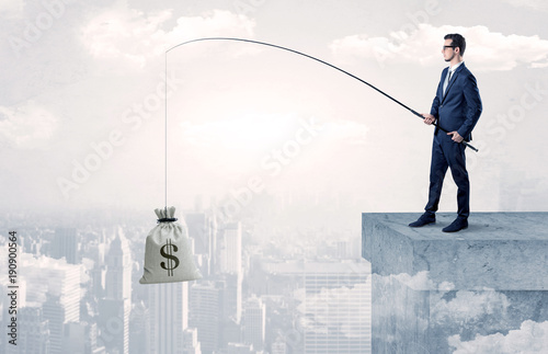 Businessman fishing currency from the city concept