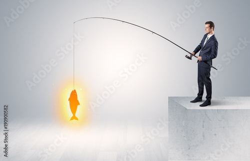 Businessman fishing golden fish concept