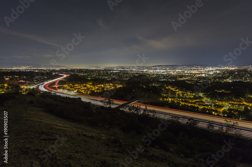 Night hilltop view of route 118 freeway entering the San Fernando Valley area in Los Angeles California.