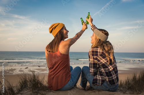 Making a toast on the beach