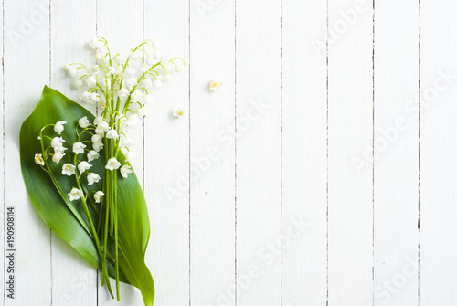 Fotobehang Lelietjes van dalen Lily of the valley on white wooden