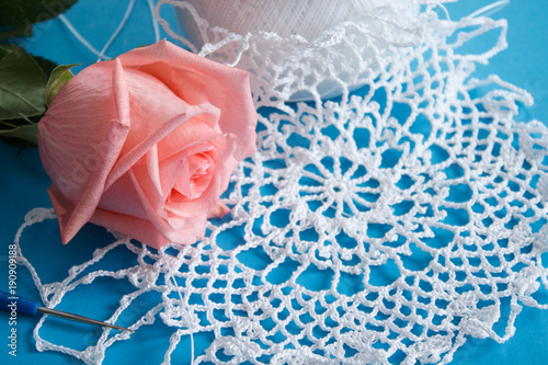 Pink rose and lace. Celebratory background. Selective focus.