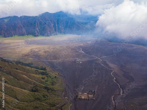 Foto op Plexiglas Aubergine Tengger caldera, hindu monastery and car parking, aerial view from drone. Bromo Tengger Semeru National Park, East Java, Indonesia