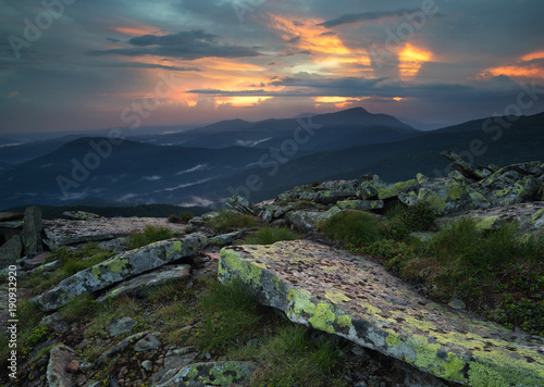Mountain panorama during sundown. Beautiful natural panoramic landscape in the summer time