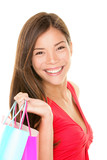 Beautiful Asian beauty woman smiling portrait holding shopping bags. Multiracial girl isolated on white background, studio cutout. - 190934138