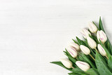 White tulips bouquet on white wooden background. Copy space, top view - 190935980