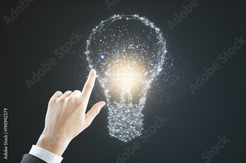 Hand pointing at polygonal lamp