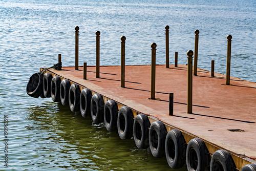 Fotobehang Peking Dock With Tires