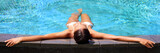 Luxury resort woman relaxing in infinity swim pool. Asian young adult lying down in swimming pool of beach resort for summer holidays or travel vacations banner. - 190974587
