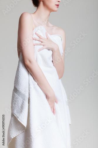 Beauty woman in white bath towel.