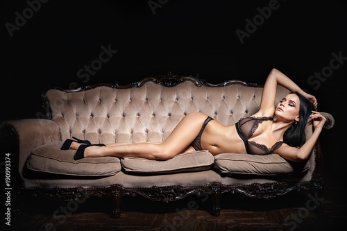 Beautiuful girl in a sexy lingerie on a sofa