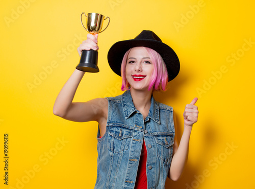 girl with pink hairstyle with winner trophy