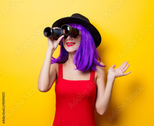 hipster girl with purple hairstyle and binoculars