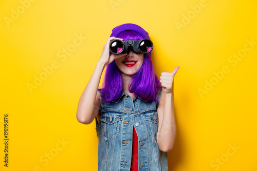 hipster girl with purple hair and binoculars