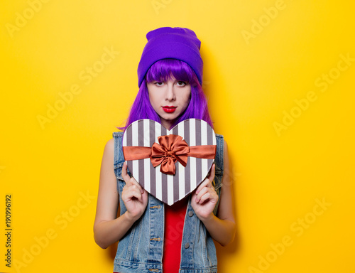 hipster girl with pink hairstyle with heart shape box