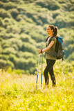 Young woman is hiking in mountain and enjoying nature.  - 191000744