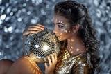 Portrait of young woman with disco ball in hands. - 191011748