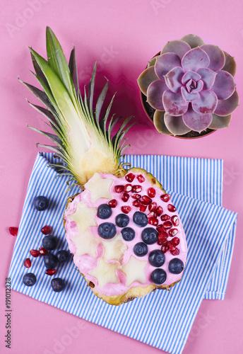 Tasty pineapple with yogurt and fruit