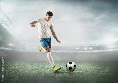 Fotobehang Voetbal Soccer player on a football field in dynamic action at summer da