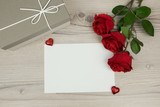 Red roses and a blank envelope card with and a gift box on wooden background,  decoration for Valentines Day, wedding day concept,  - 191013979