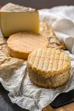 Tasting of oldest french AOC soft pudgent yellow cheese Livarot and Munster, french cheese - 191029306