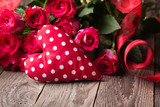 Love Background with bouquet of red roses and heart