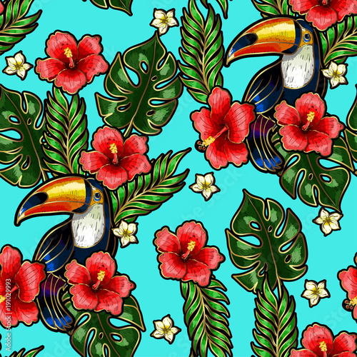 Seamless pattern of Toucan embroidery patches with tropical flowers and leaves.