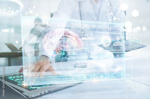 Medicine doctor in brain touching laptop and information medical network connection with modern virtual screen interface in laboratory. Technology Innovation and medicine concept © ipopba