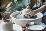 Ceramic studio, craft working process with clay potter's wheel, close-up of hands doing a pot or a vase, object - 191034724