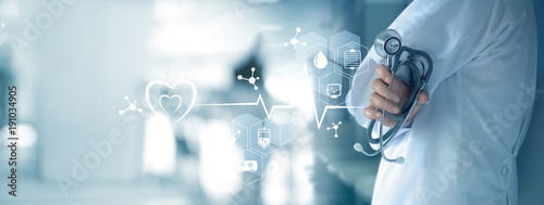 Medicine doctor with stethoscope in hand and icon medical network connection on  virtual screen interface. Modern medical technology and innovation concept © ipopba