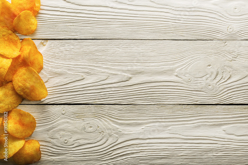 Potato Chips on old wooden table, detailed close-up, fastfood concept