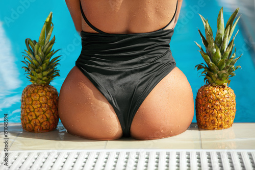Sexy Female Body In Swimsuit With Fruits.