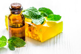 organic cosmetics with herbal extracts of mint on wooden backgro - 191046508