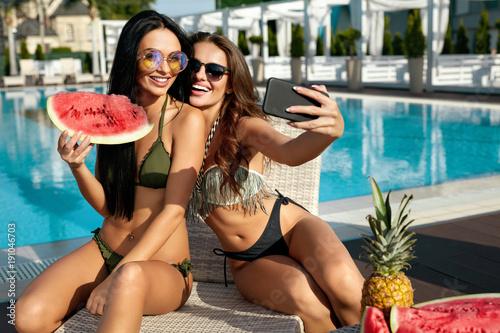 Summer Fashion. Girls Having Fun Taking Photos Near Pool.