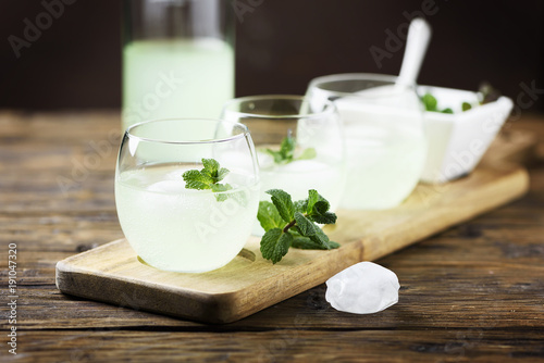 Summer cocktail with rum, ice and mint
