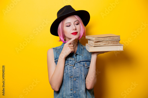 hipster girl with pink hairstyle with books