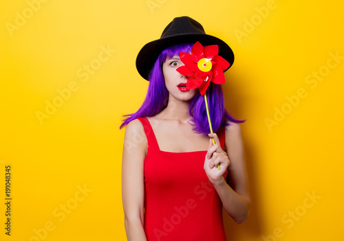 hipster girl with purple hairstyle with pinwheel