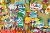 Cuban national flags, palm, Che Guevera portraits and other fridge magnet / souvenirs typical for Cuba sold in souvenir shop in street market in Cienfuegos, Cuba